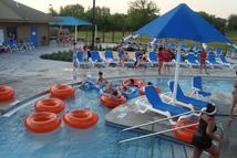 Patrons riding in flotation devices on a lazy river at a city pool